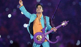 In this Feb. 4, 2007, file photo, Prince performs during the halftime show at the Super Bowl XLI NFL football game at Dolphin Stadium in Miami. Prince died at his home in Chanhassen, Minn. on April 21, 2016 at the age of 57. (AP Photo/Chris O'Meara, File)