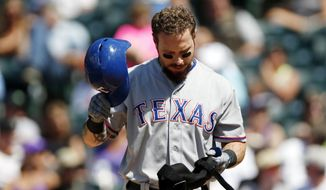 FILE - In this July 22, 2015, file photo, Texas Rangers' Josh Hamilton reacts after striking out against the Colorado Rockies in the fifth inning of a baseball game in Denver. The Rangers have released Hamilton from his minor league contract after another knee injury, perhaps signaling the end of the 2010 AL MVP's career. (AP Photo/David Zalubowski, File)