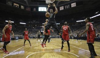 Milwaukee Bucks' Giannis Antetokounmpo dunks during the second half of game 3 of their NBA first-round playoff series basketball game against the Toronto Raptors Thursday, April 20, 2017, in Milwaukee. (AP Photo/Morry Gash)