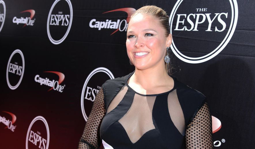 In this  July 15, 2015, file photo, Ronda Rousey arrives at the ESPY Awards at the Microsoft Theater in Los Angeles. Rousey announced her engagement to fellow MMA fighter Travis Browne on April 20, 2017. (Photo by Richard Shotwell/Invision/AP, File)