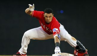 Texas Rangers' Carlos Gomez calls for time after recovering from his slide into second on a double off Kansas City Royals' Danny Duffy during the third inning of a baseball game in Arlington, Texas, Thursday, April 20, 2017. (AP Photo/Tony Gutierrez)