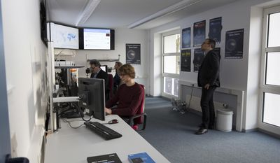 In this undated photo provided by the European Space Agency, ESA, analysts at work in the space debris facility located at ESA's ESOC mission control centre, Darmstadt, Germany. Decades' worth of man-made junk is cluttering up Earth's orbit, posing a threat to spaceflight and the satellites we rely on for weather reports, air travel and global communications. More than 750,000 fragments larger than a centimeter are already thought to orbit Earth, and each one could badly damage or even destroy a satellite. (Roberto Palmari/ESA via AP)