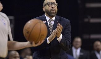 Memphis Grizzlies coach David Fizdale calls to players during the second half of Game 3 in the team's NBA basketball first-round playoff series against the San Antonio Spurs, Thursday, April 20, 2017, in Memphis, Tenn. (AP Photo/Brandon Dill)