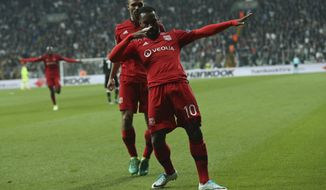 Lyon's Alexandre Lacazette, foreground celebrates scoring his side's 1st goal during a Europa League quarterfinal, second leg soccer match between Besiktas and Lyon in Istanbul, Turkey, Thursday April 20, 2017. (AP Photo/Emrah Gurel)