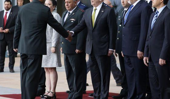U.S. Defense Secretary Jim Mattis, center, accompanied by Israeli Defense Minister Avigdor Lieberman, second right, is greeted by an Israeli military officer at the Defense Ministry in Tel Aviv, Israel, Friday, April 21, 2017. (Jonathan Ernst/Pool Photo via AP)
