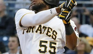 Pittsburgh Pirates' Josh Bell follows through on a two-run home run off New York Yankees starting pitcher CC Sabathia during the second inning of a baseball game in Pittsburgh, Friday, April 21, 2017. (AP Photo/Gene J. Puskar)