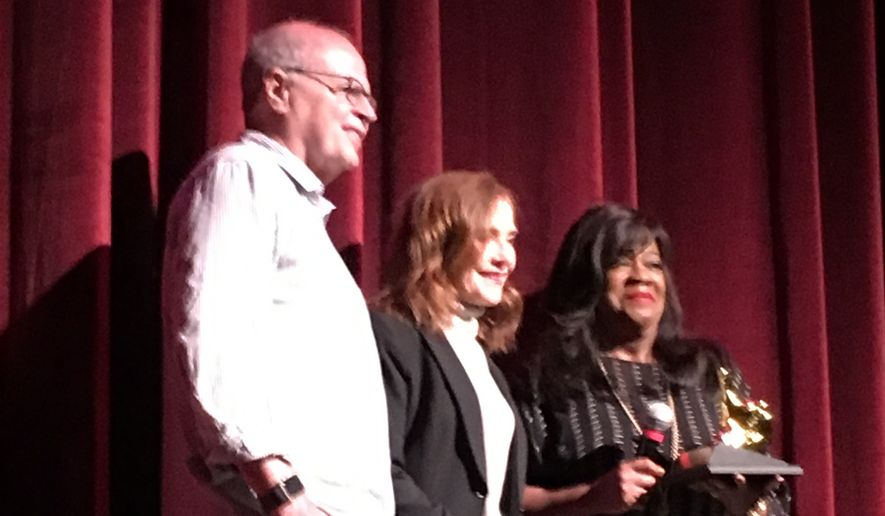 "Isabelle Huppert (center) was presented with a ""Golden Thumb"" award by Chaz Ebert (right) at Ebertfest 2017 Friday.  (Eric Althoff/The Washington Times)"