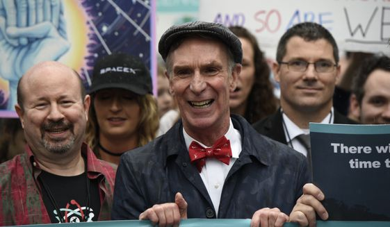 "Bill Nye ""The Science Guy"" participates in the March for Science in Washington, Saturday, April 22, 2017. Scientists, students and research advocates rallied from the Brandenburg Gate to the Washington Monument on Earth Day, conveying a global message of scientific freedom without political interference and spending necessary to make future breakthroughs possible.  (AP Photo/Sait Serkan Gurbuz)"