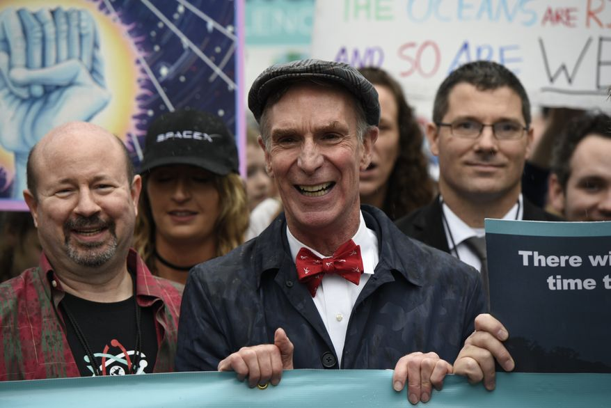 """Bill Nye """"The Science Guy"""" participates in the March for Science in Washington, Saturday, April 22, 2017. Scientists, students and research advocates rallied from the Brandenburg Gate to the Washington Monument on Earth Day, conveying a global message of scientific freedom without political interference and spending necessary to make future breakthroughs possible.  (AP Photo/Sait Serkan Gurbuz)"""