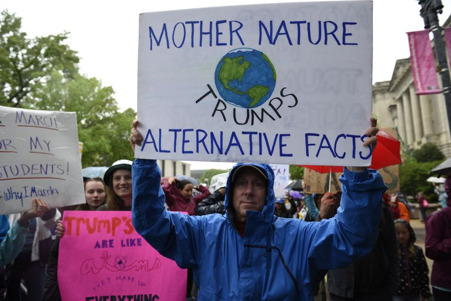 A man carries a sign during the March for Science in Washington, Saturday, April 22, 2017. Scientists, students and research advocates rallied from the Brandenburg Gate to the Washington Monument on Earth Day, conveying a global message of scientific freedom without political interference and spending necessary to make future breakthroughs possible. (AP Photo/Sait Serkan Gurbuz)