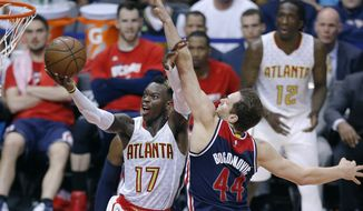 Atlanta Hawks guard Dennis Schroeder (17) shoots as Washington Wizards guard Bojan Bogdanovic (44) defends during the second half of Game 3 of an NBA basketball first-round playoff series Saturday, April 22, 2017, in Atlanta. Atlanta won 116-98. (AP Photo/John Bazemore)