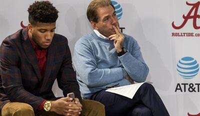 FILE - In this Jan. 13, 2017, file photo, Alabama NCAA college football coach Nick Saban sits beside Alabama defensive back Marlon Humphrey as Alabama offensive lineman Cam Robinson speaks to the media in Tuscaloosa, Ala. Alabama's defense figures to resume its dominant ways during the NFL draft. Alabama has five players projected as first-round picks in mock drafts and another five who could also be picked in the first three rounds. The group is led by potential Top 10 picks defensive lineman Jonathan Allen, tight end O.J. Howard and linebacker Reuben Foster. Mock drafts also put cornerback Marlon Humphrey and/or offensive tackle Cam Robinson as first-rounders.  (Vasha Hunt/AL.com via AP)