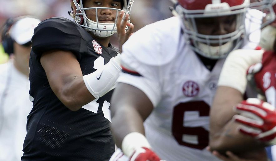 Alabama quarterback Tua Tagovailoa (13) throws behind his offensive line during its annual college football game in Tuscaloosa, Ala., Saturday, April 22, 2017. (Gary Cosby Jr./The Tuscaloosa News via AP)
