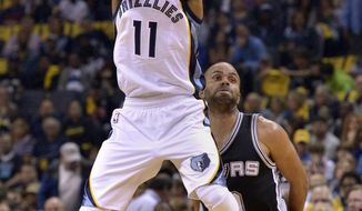 Memphis Grizzlies guard Mike Conley (11) shoots ahead of San Antonio Spurs guard Tony Parker during the first half of Game 4 in an NBA basketball first-round playoff series Saturday, April 22, 2017, in Memphis, Tenn. (AP Photo/Brandon Dill)