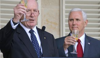 U.S. Vice President Mike Pence, right, and Australian Governor General Peter Cosgrove toast during a lunch reception for Australian and U.S. military servicemen and women at Admiralty House in Sydney, Saturday, April 22, 2017. (Jason Reed/Pool Photo via AP)