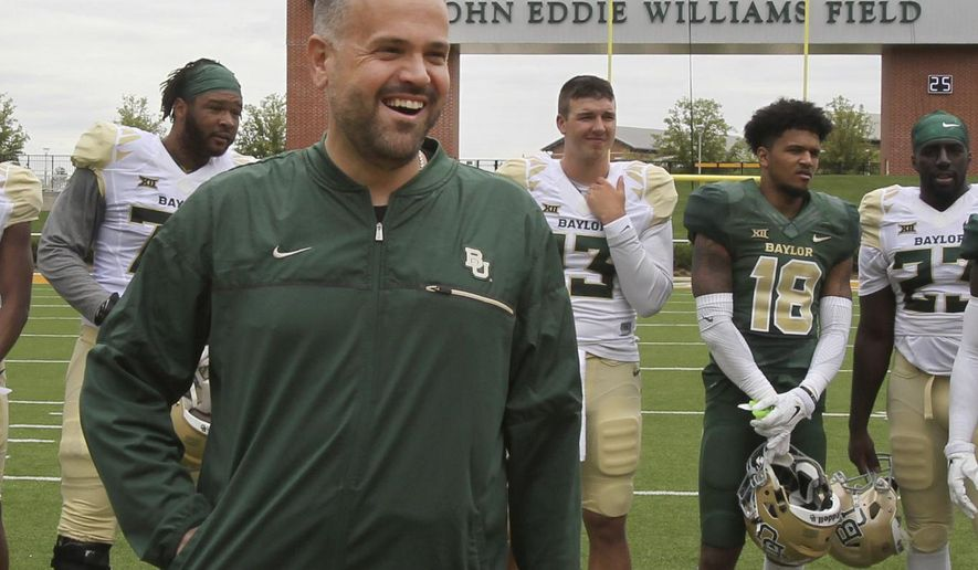 Baylor Head Football coach Matt Rhule smiles during halftime of the NCAA college football team's Green and Gold spring game, Saturday, April 22, 2017, in Waco, Texas. (Jerry Larson/Waco Tribune Herald via AP)