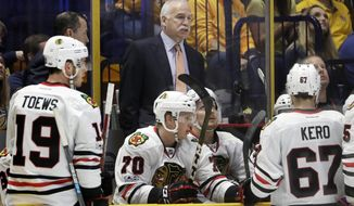 Chicago Blackhawks coach Joel Quenneville talks to his players during the first period in Game 4 of a first-round NHL hockey playoff series against the Nashville Predators on Thursday, April 20, 2017, in Nashville, Tenn. The Predators won 4-1, sweeping the series. (AP Photo/Mark Humphrey)