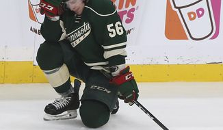 Minnesota Wild's Erik Haula (56) reacts to the team's 4-3 overtime loss to the St. Louis Blues in Game 5 of an NHL hockey Stanley Cup first-round playoff series Saturday, April 22, 2017, in St. Paul, Minn. (AP Photo/Stacy Bengs)