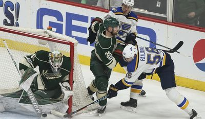 St. Louis Blues' Magnus Paajarvi (56) tries to sneak the puck into the net against Minnesota Wild's goalie Devan Dubnyk (40) during the first period of Game 5 of an NHL hockey Stanley Cup first-round playoff series Saturday, April 22, 2017, in St. Paul, Minn. (AP Photo/Stacy Bengs)