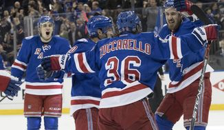 New York Rangers right wing Mats Zuccarello (36) celebrates with his teammates after scoring a second goal during the second period of Game 6 of a first-round NHL hockey Stanley Cup playoff series against the Montreal Canadiens, Saturday, April 22, 2017, at Madison Square Garden in New York. (AP Photo/Mary Altaffer)