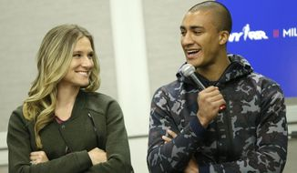 FILE - In this Feb. 18, 2016, file photo, Ashton Eaton, right, and his wife, Brianne Theisen-Eaton, participate in a news conference in New York. What are the Eatons doing after retirement? Staying busy. An urge to compete? They insist it's no longer there. (AP Photo/Seth Wenig, File)