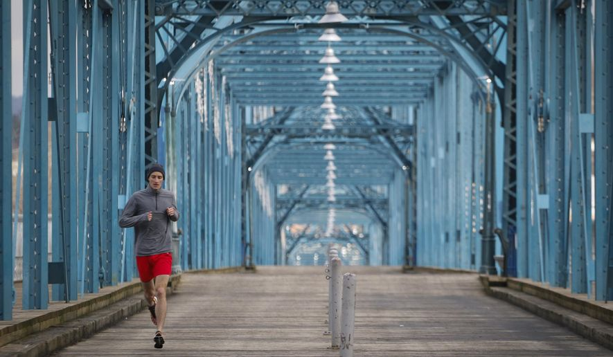 Nathan Sexton, 29, head of the Business Intelligence department for Bellhops, goes on a 5k lunch training run on Thursday, February 25, 2016. Sexton was eight and a half months into a fight with brain cancer. He went on to run in the Boston Marathon. (Dan Henry/Chattanooga Times Free Press via AP)