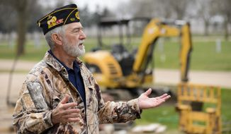 ADVANCE FOR USE SATURDAY, APRIL 22 - In this April 12, 2017 photo,  Gary Wooten, Legion commander for the Wilber American Legion, talks about their new building that is under construction at Legion Memorial Park in Wilber, Neb. (Matt Ryerson/The Journal-Star via AP)