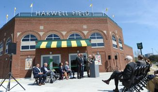 In this Tuesday April 18, 2017 photo, attorney Gary Spicer, at podium, speaks as Wayne State University in Detroit unveiled Harwell Field, the school's baseball stadium named after the late Detroit Tigers broadcaster Ernie Harwell.  (Max Ortiz/Detroit News via AP)
