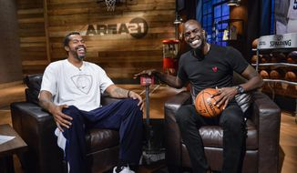 "In this photo provided by Turner Sports, Kevin Garnett, right, talks with Rasheed Wallace on the set of  ""Area 21,"" his show-within-a-show on TNT's wildly popular basketball production. In a first for Turner Sports, the segments are geared toward social media first, and Garnett is plunging head-first into the project. (Ted Pio-Roda/Turner Sports via AP)"