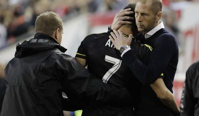 Columbus Crew midfielder Artur (7) is hugged by coach Gregg Berhalter, right, after Artur left the game with an injury suffered during the first play of an MLS soccer match, Saturday, April 22, 2017, in Harrison, N.J. (AP Photo/Julio Cortez)