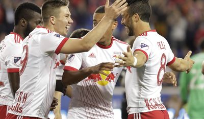 New York Red Bulls midfielder Alex Muyl, left, celebrates his goal with Felipe Martins, right, and teammates during the first half of an MLS soccer match against the Columbus Crew, Saturday, April 22, 2017, in Harrison, N.J. (AP Photo/Julio Cortez)