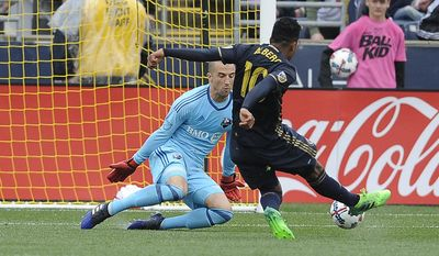 Philadelphia Union midfielder Roland Alberg (10) scores a goal on Montreal Impact goalkeeper Evan Bush during the first half of an MLS soccer match on Saturday, April 22, 2017, in Chester, Pa. (AP Photo/Michael Perez)