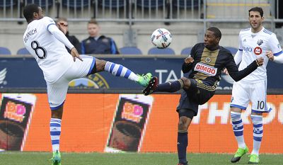 Montreal Impact midfielder Patrice Bernier (8) and Philadelphia Union defender Ray Gaddis battle for the ball during the first half of an MLS soccer match on Saturday, April 22, 2017, in Chester, Pa. (AP Photo/Michael Perez)