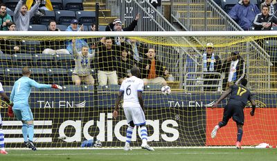 Philadelphia Union forward C.J. Sapong (17) score a goal against Montreal Impact goalkeeper Evan Bush (1) and defender Hassoun Camara (6) during the first half of an MLS soccer match on Saturday, April 22, 2017, in Chester, Pa. (AP Photo/Michael Perez)