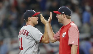 Washington Nationals first baseman Ryan Zimmerman (11), left, celebrates with pitcher Max Scherzer (31) after the Nationals defeated the Atlanta Braves 3-2 in a baseball game Thursday, April 20, 2017, in Atlanta. Zimmerman hit a two-run home. Scherzer did not play. (AP Photo/John Bazemore) **FILE**