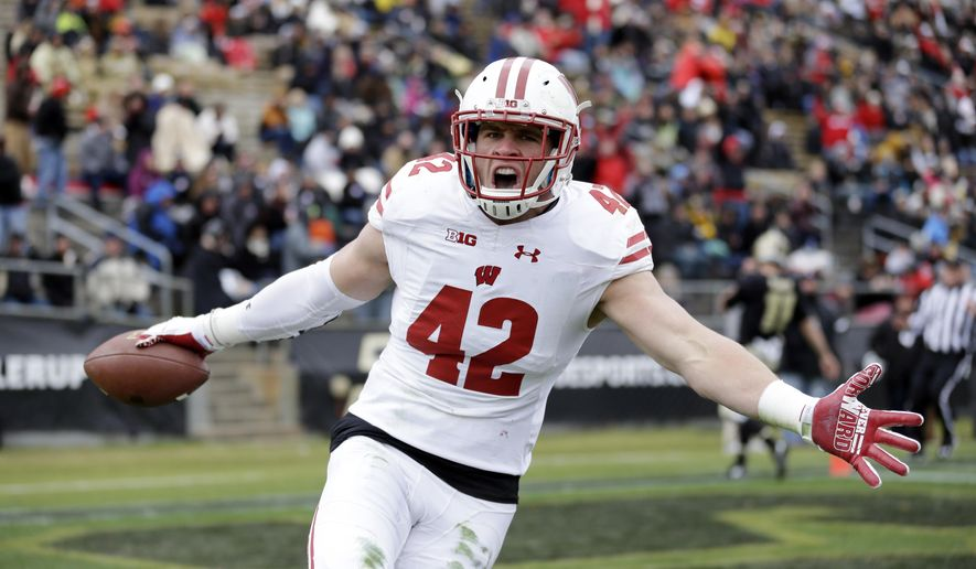 FILE - This Nov. 19, 2016, file photo shows Wisconsin linebacker T.J. Watt (42) celebrating after returning an interception for a touchdown during the first half of an NCAA college football game against the Purdue in West Lafayette, Ind. Frame to grow into a full-time defensive end, but not necessarily the athleticism to be an elite rusher. Last quarter of the first round. (AP Photo/Michael Conroy, File)