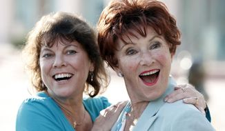 "FILE - In this June 18, 2009 file photo, actresses Erin Moran, left, and Marion Ross pose together at the Academy of Television Arts and Sciences' ""A Father's Day Salute to TV Dads"" in the North Hollywood section of Los Angeles. Moran, the former child star who played Joanie Cunningham in the sitcoms ""Happy Days"" and ""Joanie Loves Chachi,"" has died at age 56. Police in Harrison County, Indiana said that she had been found unresponsive Saturday, April 22, 2017, after authorities received a 911 call. (AP Photo/Matt Sayles, File)"