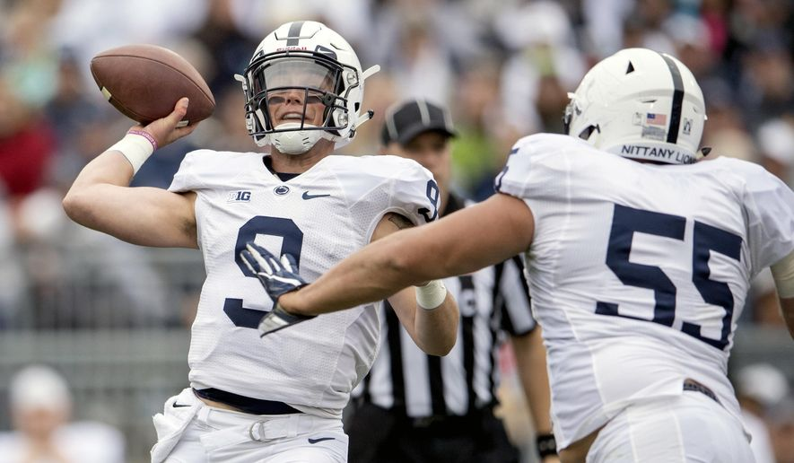 Penn State quarterback Trace McSorley passes as he is pressured by Antonio Shelton during the NCAA college football team's Blue-White game Saturday, April 22, 2017, in State College, Pa. (Abby Drey/Centre Daily Times via AP)