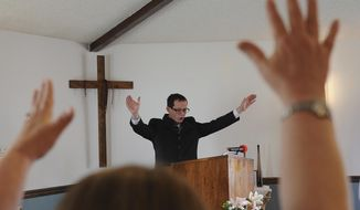 In this Sunday, April 9, 2017 photo, Pastor David Fisher leads a prayer during church service at Faithpoint Ministries in Prineville, Ore.(Ryan Brennecke /The Bulletin via AP)