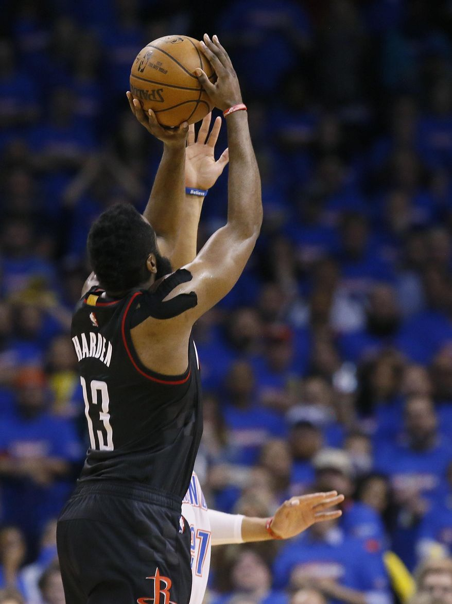 Houston Rockets guard James Harden (13) misses a 3-pointer as Oklahoma City Thunder forward Andre Roberson, rear, defends in the final seconds of Game 3 of a first-round NBA basketball playoff series in Oklahoma City, Friday, April 21, 2017. Oklahoma City won 115-113. (AP Photo/Sue Ogrocki)