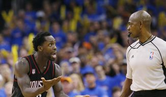 Houston Rockets guard Patrick Beverley (2) questions official Tom Washington, right, during the fourth quarter of the team's first-round NBA basketball playoff game against the Oklahoma City Thunder in Oklahoma City, Friday, April 21, 2017. Oklahoma City won 115-113. (AP Photo/Sue Ogrocki)