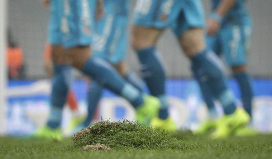 A damaged part of the pitch, during the Russian national championship match between Zenit St.Petersburg and Ural Yekaterinburg at the new St. Petersburg's soccer stadium on Krestovsky Island, in St.Petersburg, Russia, Saturday, April 22, 2017.  The stadium which will host matches for the 2018 World Cup has held its first game with much fanfare, a ragged pitch and three red cards. (AP Photo/Dmitri Lovetsky)