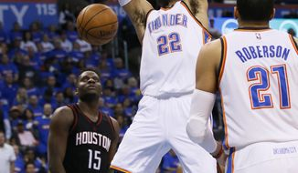 Oklahoma City Thunder forward Taj Gibson (22) dunks in front of Houston Rockets center Clint Capela (15) in the third quarter of Game 3 of a first-round NBA basketball playoff series in Oklahoma City, Friday, April 21, 2017. The move to get 6-foot-9 Gibson is paying dividends and has helped the Thunder get back in the series against the Rockets. (AP Photo/Sue Ogrocki)