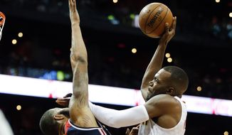 Atlanta Hawks forward Paul Millsap (4) goes to the basket against Washington Wizards forward Markieff Morris (5) during the first half of an NBA playoff basketball game Saturday, April 22, 2017, in Atlanta. (AP Photo/John Bazemore)
