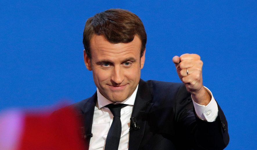 "French centrist presidential candidate Emmanuel Macron, addressing cheering supporters in Paris on Sunday, told them they are ""the faces of French hope"" and vowed to be a president ""who protects, who transforms and builds."" The centrist ex-banker who set up his party just a year ago garnered the most votes. (Associated Press)"