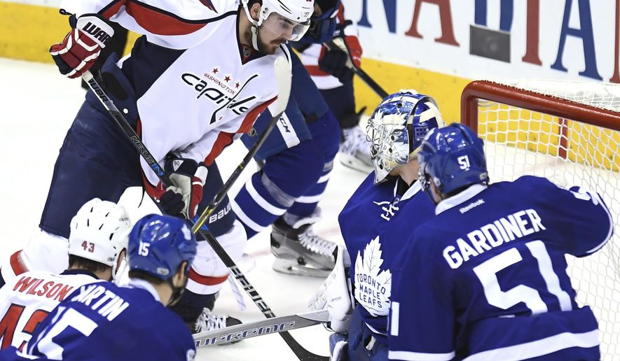 Washington Capitals centre Marcus Johansson (90) scores against the Toronto Maple Leafs during the third period of Game 6 of an NHL hockey Stanley Cup first-round playoff series in Toronto on Sunday, April 23, 2017. (Frank Gunn/The Canadian Press via AP)