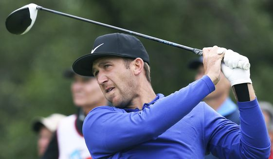 Kevin Chappell hits into the wind on the 9th tee during the third round of the Valero Texas Open at TPC San Antonio Oaks Course in San Antonio, Texas, Saturday, April 22, 2017. (Tom Reel/The San Antonio Express-News via AP)