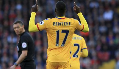 Crystal Palace's Christian Benteke celebrates scoring against Liverpool during the English Premier League soccer match at Anfield, Liverpool, Sunday April 23, 2017. (Peter Byrne/PA via AP)