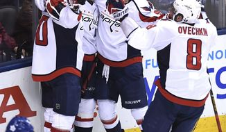 Washington Capitals center Marcus Johansson (90), left to right, celebrates with right wing Justin Williams (14) centre Evgeny Kuznetsov (92) and left wing Alex Ovechkin (8) after scoring against the Toronto Maple Leafs during overtime of Game 6 of an NHL hockey Stanley Cup first-round playoff series in Toronto on Sunday, April 23, 2017. The Washington Capitals beat the Maple Leafs 2-1 on Sunday to capture the best-of-seven Eastern Conference quarter-final series in six games. (Frank Gunn/The Canadian Press via AP)
