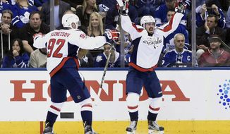 Washington Capitals centre Marcus Johansson (90) celebrates with center Evgeny Kuznetsov (92) after scoring against the Toronto Maple Leafs during Game 6 of an NHL hockey Stanley Cup first-round playoff series in Toronto on Sunday, April 23, 2017. The Washington Capitals beat the Maple Leafs 2-1 on Sunday to capture the best-of-seven Eastern Conference quarter-final series in six games. (Nathan Denette/The Canadian Press via AP)